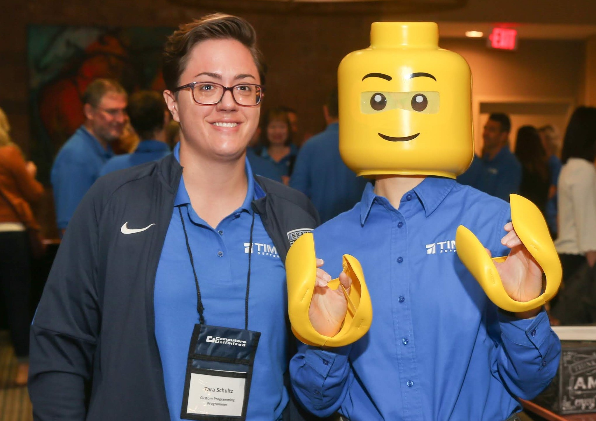 A LEGO character poses with a Computers Unlimited team member during Users Group 2019. Click to see more.